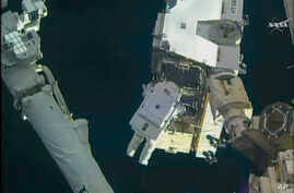In this still image taken from video provided by NASA, astronaut Peggy Whitson takes a spacewalk outside the International Space Station on Friday, Jan. 6, 2016.