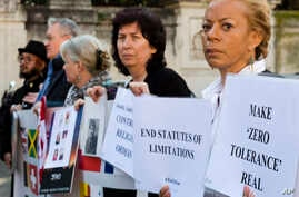 Psychoneurologist and founding member of the Ending Clergy Abuse organization, Denise Buchanan, right, and member Leona Huggins, second from right, participate in a protest outside the St. Anselm on the Aventine Benedictine complex in Rome, Feb. 22,