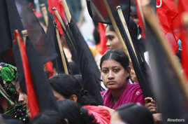 Garment workers take part in a rally against the deaths of their colleagues after a devastating fire in a garment factory in Dhaka, November 27, 2012.