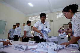 FILE - Members of the National Election Committee (NEC) count ballots during a senate election in Phnom Penh, Cambodia, Feb. 25, 2018.