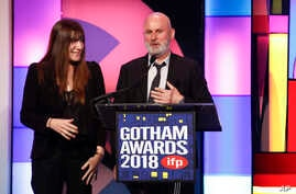 """2""""The Rider"""" producers Mollye Asher, left, and Bert Hamelinck, accept the Best Feature Film award at the 28th annual Independent Filmmaker Project's Gotham Awards on Nov. 26, 2018, in New York."""