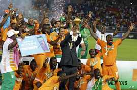 Ivory Coast players celebrate with the trophy after winning their African Football Cup of Nations final against Ghana in Bata, Equatorial Guinea, Feb. 8, 2015.  The tournament returns to Gabon for the second time in five years beginning Jan. 14, 2017