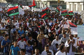 Protesters chant slogans against armed militias during a march in Benghazi city, September 21, 2012.