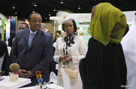 Mswati III, King of Swaziland (L) tours the exhibition hall during the first day of the World Energy Forum at the Dubai World Trade Centre, Oct. 22, 2012.