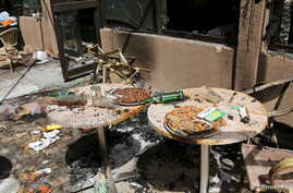 Pizzas are seen on the terrace of Cappuccino restaurant after an attack on the restaurant and the Splendid Hotel in Ouagadougou, Burkina Faso, Jan. 18, 2016.