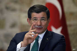 Turkish Prime Minister Ahmet Davutoglu speaks to a group of foreign reporters in Istanbul, Turkey, Dec. 9, 2015.