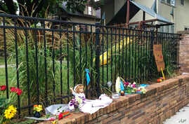 Items are placed at a makeshift memorial, the scene where a police officer fatally shot Justine Damond, of Sydney, Australia, July 18, 2017, in Minneapolis.