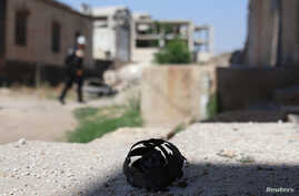 The remains of a cluster bomblet is pictured in the rebel-held town of Dael in Daraa Governorate, Syria, June 27, 2017.