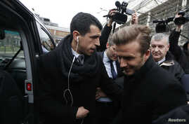 Soccer player David Beckham is seen at the Pitie-Salpetriere hospital for his medical examination in Paris January 31, 2013.