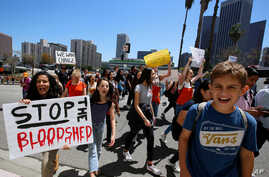 Hundreds of students walk out of school to rally against gun violence, April 20, 2018, in downtown Los Angeles. Protests were held across the country Friday, on the 19th anniversary of the Columbine High School shooting.