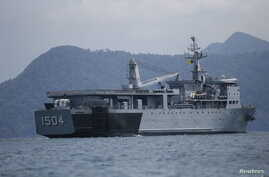 FILE - A Malaysian navy vessel patrols waters near Langkawi Island, May 16, 2015. Malaysia is buying four ships from China to help it patrol its coastline.