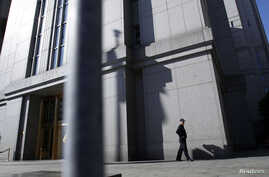 FILE - Court officer walks outside Federal Courthouse in Manhattan, where court papers were filed this week on behalf of Minh Quang Pham, who has pleaded not guilty to charges he provided material support to al-Qaida in the Arabian Peninsula.