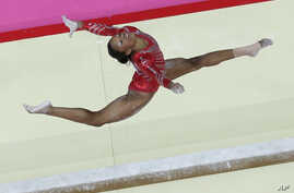 US gymnast Gabrielle Douglas performs on the balance beam during the Artistic Gymnastic women's team final at the 2012 Summer Olympics in London, July 31, 2012.