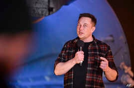 Elon Musk, co-founder and chief executive officer of Tesla Inc., speaks during an unveiling event for the Boring Co. Hawthorne test tunnel in Hawthorne, California., Dec. 18, 2018.