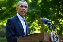 President Barack Obama speaks about developments in Iraq from Chilmark, Massachusetts, during his family vacation on the island of Martha's Vineyard, Aug. 11, 2014.