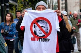 FILE - A street vendor sells an anti-President Trump T-shirt during a protest outside Los Angeles City Hall, in Los Angeles, California, Feb. 20, 2017.
