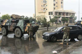 Lebanese army soldiers man a checkpoint as they are deployed in Tripoli, northern Lebanon, Dec. 3, 2013.