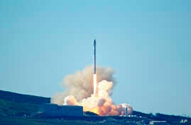 SpaceX's Falcon 9 rocket is launched launches at Vandenberg Air Force Base, Calif., Jan. 14, 2017. The two-stage rocket lifted off to place 10 satellites into orbit for Iridium Communications Inc.