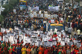 Supporters of Bangladesh Awami League march along a street as they take part in a rally ahead of Dec. 30 general election vote, in Dhaka, Dec. 27, 2018.