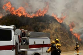 Firefighters battle the so-called Sand Fire in the Angeles National Forest near Los Angeles, California, July 25, 2016.
