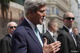 U.S. Secretary of State John Kerry talks to the media on his way to a meeting at a hotel in Vienna, July 13, 2014.