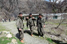 Kurdistan Workers Party (PKK) fighters stand guard at the Qandil mountains near the Iraq-Turkish border in Sulaimaniya, northeast of Baghdad, Iraq March 24, 2013.