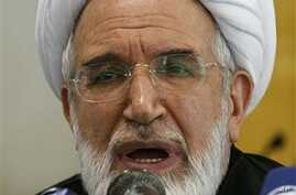 Iranian Pro-reform clergyman Mehdi Karroubi, who heads the Etemad-Melli, the National Trust party, talks during a press conference in Tehran, Iran (File Photo)