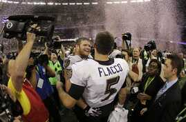 Baltimore Ravens quarterback Joe Flacco (5) and offensive lineman Marshal Yanda (73) celebrate their team's 34-31 win against the San Francisco 49ers in the NFL Super Bowl XLVII football game, Sunday, Feb. 3, 2013, in New Orleans.