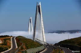 FILE - Yavuz Sultan Selim bridge covered by fog over the Bosphorus, Istanbul,  April 27, 2017.