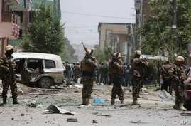 Afghan security personnel inspect the site of a suicide attack that targeted a NATO convoy in Kabul, Afghanistan, July 7, 2015.