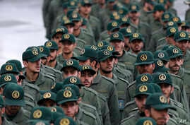 Iranian Revolutionary Guard members arrive for a ceremony celebrating the 40th anniversary of the Islamic Revolution, at the Azadi, or Freedom, Square, in Tehran, Iran, Feb. 11, 2019.