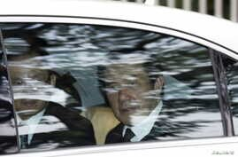 FILE - Taiwan's President Ma Ying-jeou leaves the Istana after paying his respects to Singapore's first prime minister Lee Kuan Yew, in Singapore.