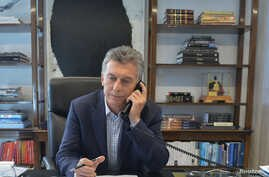 Argentina's President Mauricio Macri speaks by phone with U.S. President Donald Trump, in Buenos Aires, Argentina, Feb. 15, 2017.
