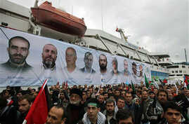 A banner depicting the faces of the nine men killed, displayed on the Mavi Marmara ship, on its returns, in Istanbul, Turkey, 26 Dec 2010