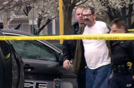 In this Sunday, April 13, 2014 image from video provided by KCTV-5, Frazier Glenn Cross, also known as Frazier Glenn Miller, is escorted by police in an elementary school parking lot in Overland Park, Kansas.