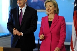 Secretary of State Hillary Clinton (R) walks with Greek Prime Minister George Papandreou before news conference in Washington, 8 Mar 2010