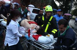 A woman is evacuated on a gurney after an explosion at the Centro Andino shopping center in Bogota, Colombia, June 17, 2017.