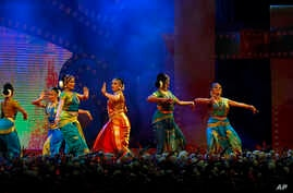 FILE - Indian dancers perform classical dance at the opening ceremony of Bengaluru International Film Festival (BIFFES), at the lawns of Vidhana Soudha, the seat of the state legislature of India's southern state of Karnataka, Bangalore, India,  Jan.