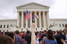 The crowd celebrates outside of the Supreme Court after the court declared that same-sex couples have a right to marry anywhere in the United States, in Washington, D.C., June 26, 2015.