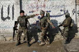 Afghan National Army (ANA) soldiers arrive after a blast near the Pakistani consulate in Jalalabad, Afghanistan, Jan. 13, 2016.