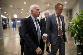 Sen. John McCain, R-Ariz., chairman of the Senate Armed Services Committee, arrives for a closed-door briefing on the situation in Niger where four U.S. soldiers were killed in an ambush earlier this month, on Capitol Hill in Washington, Oct. 26, 201