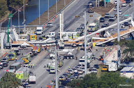Aerial view shows a pedestrian bridge collapsed at Florida International University in Miami, Florida, March 15, 2018.