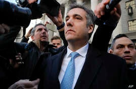 Michael Cohen walks out of federal court, Nov. 29, 2018, in New York.