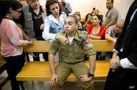 FILE - Israeli solider Elor Azaria sits inside an Israeli military court in Tel Aviv, Israel, in an April 18, 2016, photo. If convicted, Azaria faces up to 20 years in prison.
