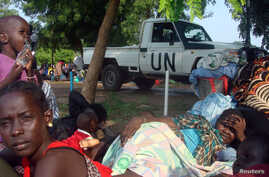 A U.N. truck drives past displaced South Sudanese families resting in a camp for internally displaced people in the United Nations Mission in South Sudan (UNMISS) compound in Tomping, Juba, July 11, 2016.