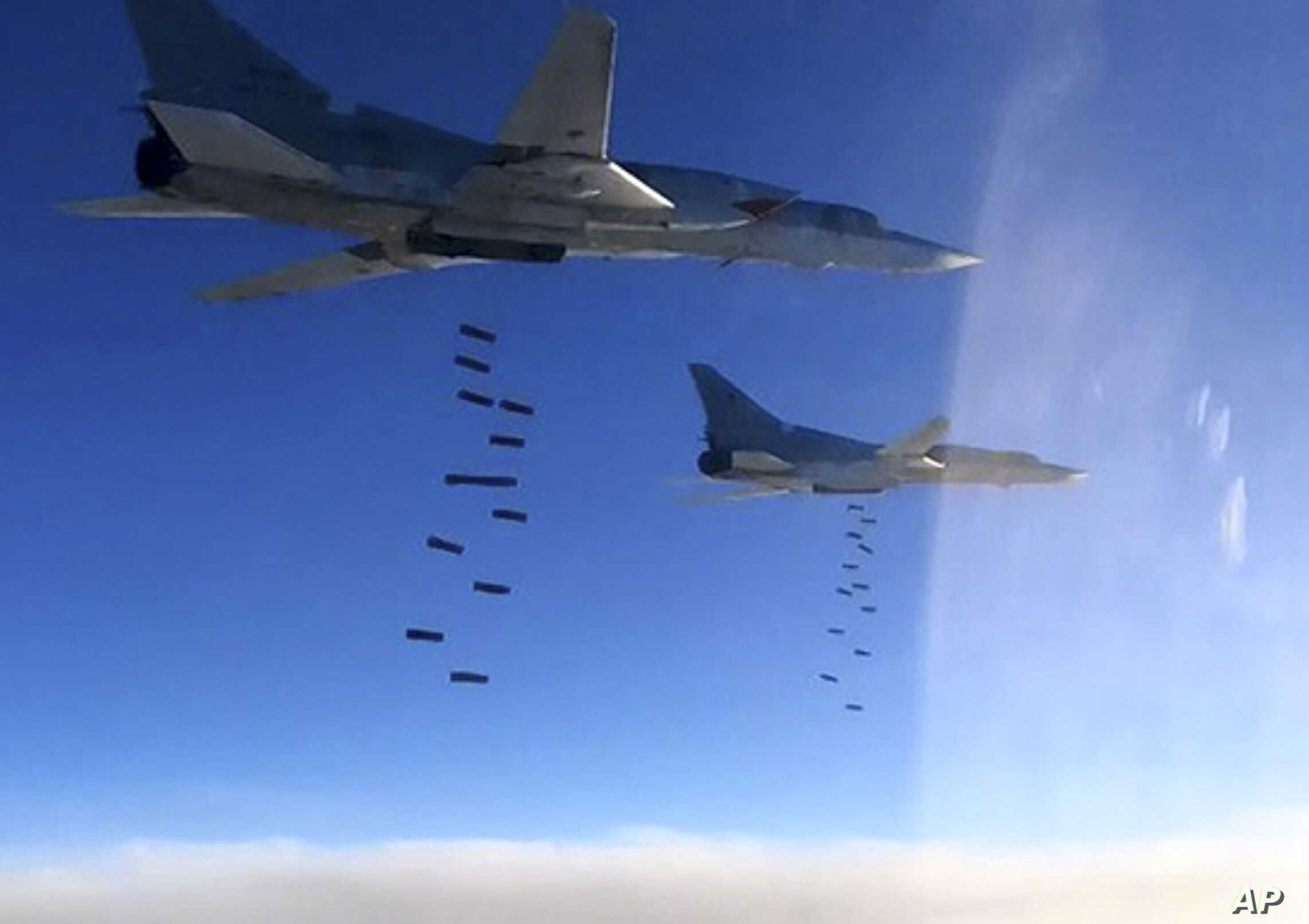 This photo provided by the Russian Defense Ministry Press Service purportedly shows Russian air force Tu-22M3 bombers striking Islamic State group targets in Syria, Jan. 23, 2017.