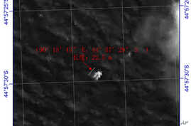 This image provided by China's State Administration of Science, Technology and Industry for National Defense shows a floating object seen at sea next to the descriptor which was added by the source.