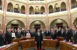 Hungarian President Janos Ader (C) swears in during his inauguration ceremony for a second five-year term attended by Hungarian Prime Minister Viktor Orban )front row, 3rd R) at the plenary session of the Hungarian Parliament in Budapest, Hungary, Ma