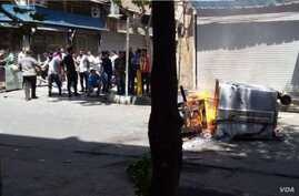 Anti-government protesters angered by Iran's worsening economy set fire to garbage cans in Tehran's Laleh Zar district, June 26, 2018.