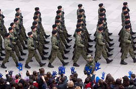 Kosovo Security Force members parade in the center of Pristina marking the 5th anniversary since Kosovo seceded from Serbia , Feb. 17, 2013.